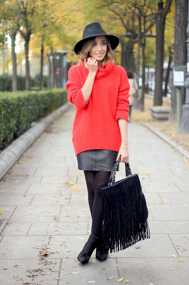 Red knitted sweater and black leather skirt