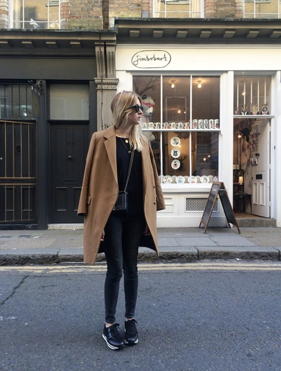 Total black look and camel coat
