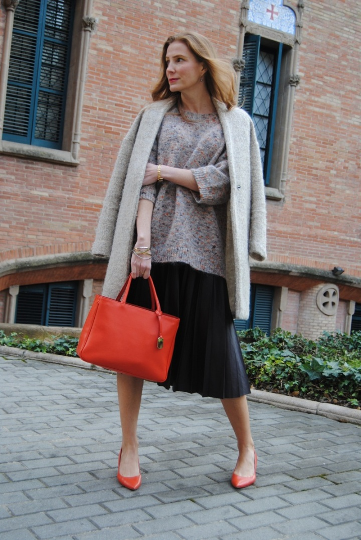 Oversize sweater and pleated leather skirt