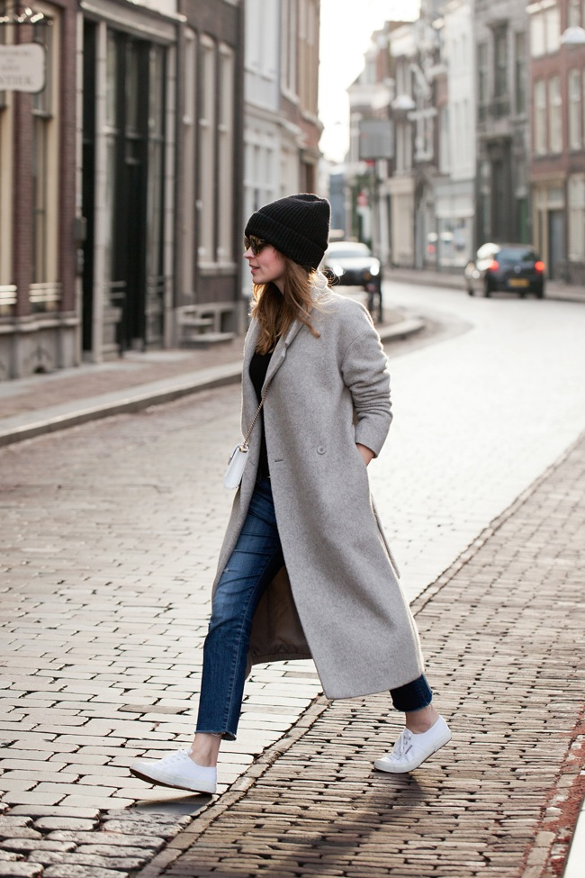 Grey coat and white sneakers