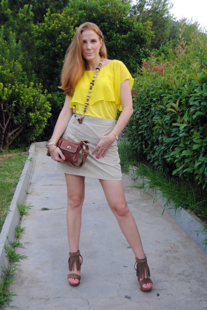 Frills blouse, A line skirt and fringed shoes