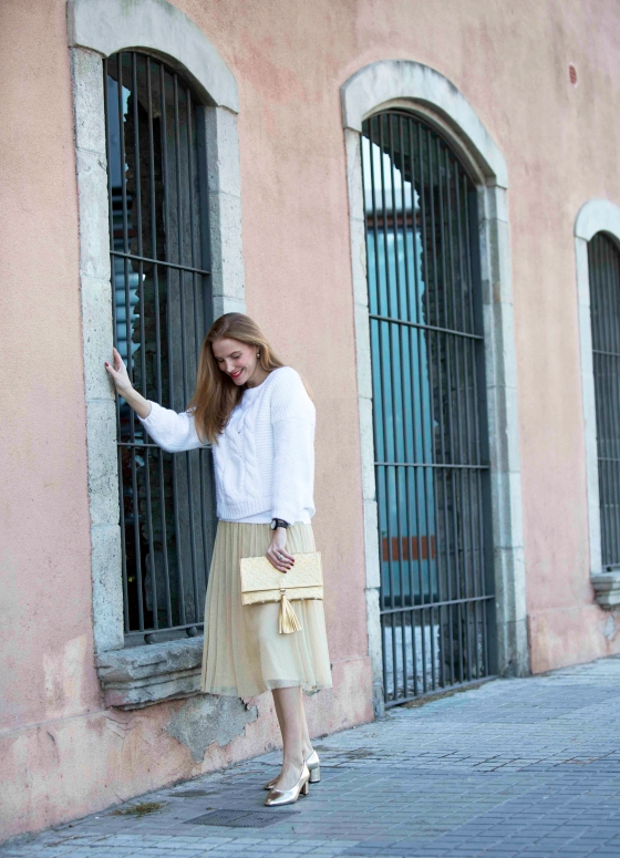 golden skirt and white sweater