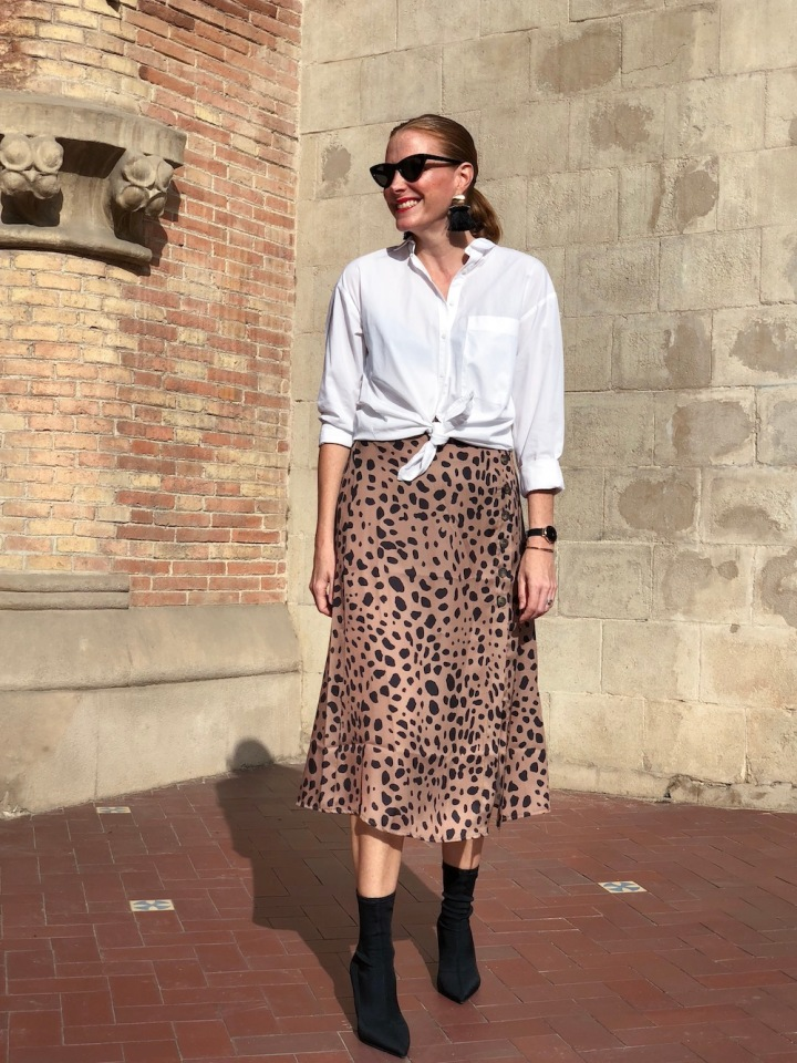white blouse and leopard print skirt